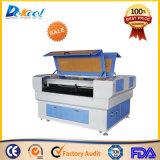 Engraver da tavolino della macchina per incidere di taglio del laser del CO2 per le schede di cristallo di colore degli indumenti da vendere