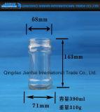 Bottiglia di vetro tradizionale con il coperchio del metallo per ostruzione