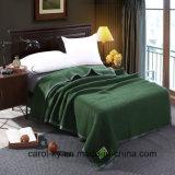 Manta verde del hotel de las lanas