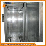 Un pequeño polvo industrial eléctrico de la puerta que cura el horno Pulver Herdeovn