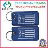 Kundenspezifisches preiswertes Stickerei-Gewebe Keychain, entfernen vor Flug-Schlüsselkette
