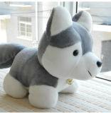 Legame della sciarpa della peluche che si siede i giocattoli molli della peluche del cane