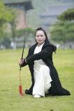 Wudang Taiのキーの女性の落下および冬の厚いローブの厚く自然なリネンコート