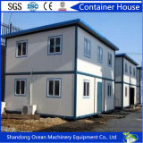 Casa prefabricada bien del envase del bastidor de acero y del panel de emparedado para la vida temporal