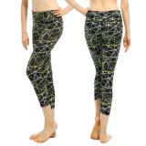 Pantaloni di yoga di usura di sport delle donne con i reticoli irregolari