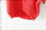 Brevi vestiti lavorati a maglia rossi per le donne