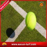 Erba artificiale della corte di tennis con l'alta qualità