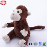 Animal de singe reposant le jouet mou gentil à croquer adorable de peluche