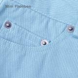 O algodão 100% do azul caçoa as crianças das calças que vestem a venda em linha