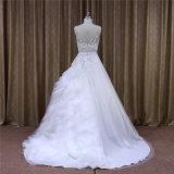 Une ligne cristal de lacet d'organza perlant la robe de mariage chaude de vente