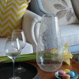 広い口の空気泡が付いているガラス瓶の花つぼ