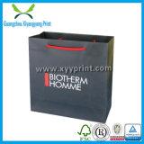Vente en gros de papier noire de sac de cadeau estampée par logo fait sur commande de luxe