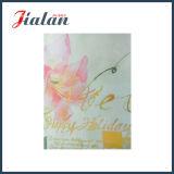 Sac de papier de modèle de fleur de clinquant d'or avec l'étiquette