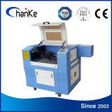 Mini gravure de laser et machine de découpage pour le caoutchouc/plastique/bois