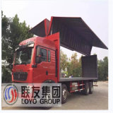 Camion aperto tre Axles Ving Van Truck Steel della casella di HOWO dell'ala resistente del Van Hydraulic Side