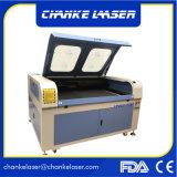 El laser del CO2 graban y la cortadora para cortar el PVC de Farbic