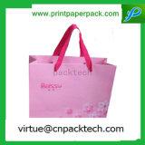 색깔 리본을%s 가진 호화스러운 재상할 수 있는 분홍색 형식 선물 종이 봉지