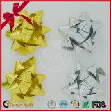 Curvas douradas da estrela para a decoração da embalagem