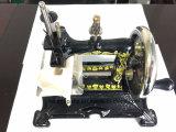 Mini máquina de coser manual
