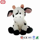 Blanc de vache reposant le jouet mou promotionnel simple de face mignonne