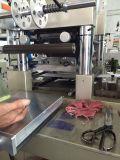 Maquinaria cortando do papel de etiqueta do ATM