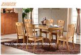 簡潔な家具によって折られる木表の固体木のダイニングテーブル