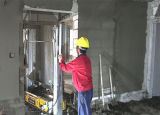 La colle de construction plâtrant la machine pour la construction