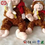 Jouet mou se reposant de peluche de singe de cadeau brun clair de Noël beau