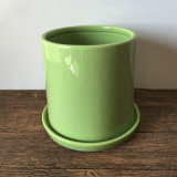 光沢のある緑の円柱陶磁器の鍋