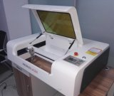 Machine de coupeur de graveur de laser pour la pierre en bois de forces de défense principale