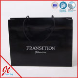 Le prix inférieur a réutilisé le sac de papier estampé par coutume de cadeau blanc de Papier d'emballage, sac à provisions de papier