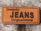 Горячий ярлык кожи джинсыов одежды способа