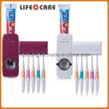 Tocarme dispensador de la crema dental y sostenedor automático del cepillo de dientes