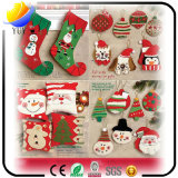 Reizende und heiße verkaufenweihnachtssocken und der fördernde Weihnachtshut für Weihnachtsdekoration-Geschenke