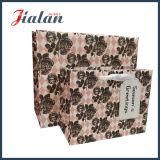 Las ventas al por mayor modifican la bolsa de papel para requisitos particulares al por menor impresa nuevo diseño hecha insignia