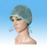 La protezione chirurgica a gettare, il cappello dei chirurghi, verde frega le protezioni