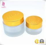 Bereifter/transparenter kosmetischer Behälter bilden das Sahnekappen-Balsam-Glas, das mit goldenen Splitter-Kappen verpackt