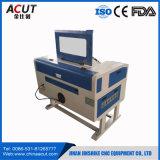 Máquina de estaca acrílica da gravura do CNC do laser do papel/pano mini