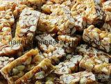 Doces do amendoim que fazem a máquina com moldes