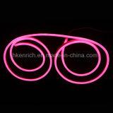 분홍색 색깔 표시를 만들기를 위한 네온 코드 빛
