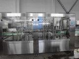Vino automatico Traid in una linea di produzione di riempimento