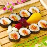 De hand Snijder van het Broodje van Maki van Sushi Suzumo