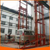 Elevador elétrico hidráulico do assoalho do trilho de guia para a carga de levantamento dos bens