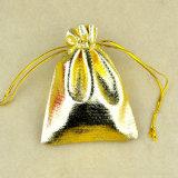 小さいクリスマスの金カラーギフトのドローストリング袋
