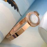 Form-Schmucksache-Edelstahl-Armband-weißes Shell-Diamant-Stulpe-Armband