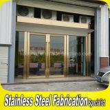 Portello di entrata di vetro del metallo dell'acciaio inossidabile di obbligazione esterna di lusso dorata dell'oscillazione