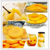 Comer para fora o pêssego amarelo saudável enlatado