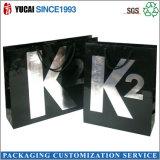 Sac de empaquetage de logo de noir de papier de vêtement argenté de sac à provisions