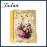 O projeto feito sob encomenda do logotipo do teste padrão de flor fêz o saco de papel por atacado barato