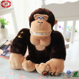 La peluche de coton bourrée mignonne de gorille de muscle badine le jouet de singe
